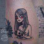 Smutny graficzny tatuaż