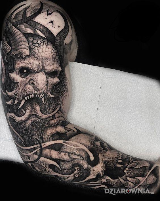 Tatuaż diabel na rece w motywie czaszki i stylu graficzne / ilustracyjne na ramieniu