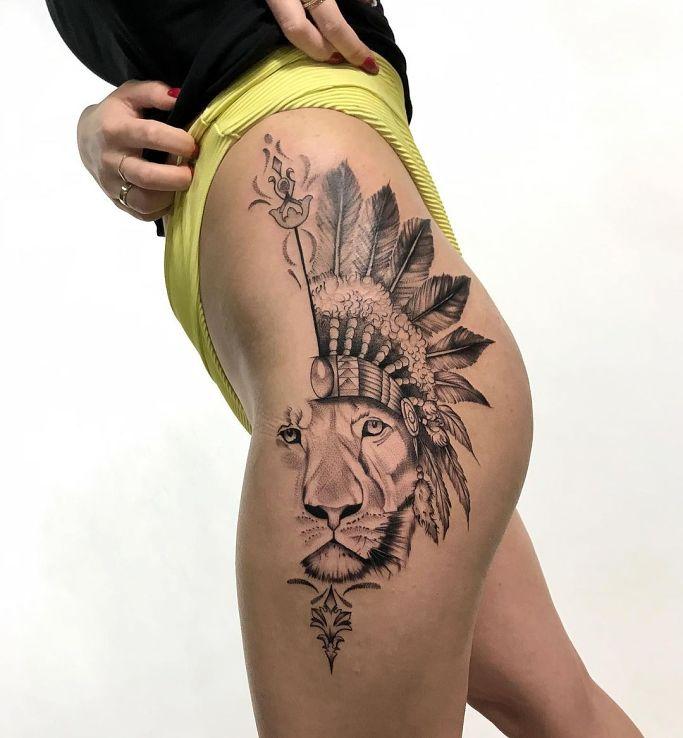 Tatuaż lew w motywie zwierzęta i stylu graficzne / ilustracyjne na udzie