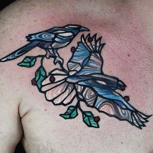 Tatuaż dwa ptaki w motywie zwierzęta na klatce